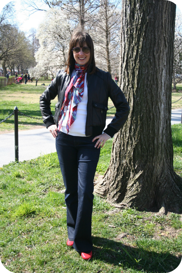"Working mom outfit of the week: Color ""unblocking."" A weekend chic look featuring white sweater and T-shirts with Paige bootcut denim, red flats, and multicolored sweater."