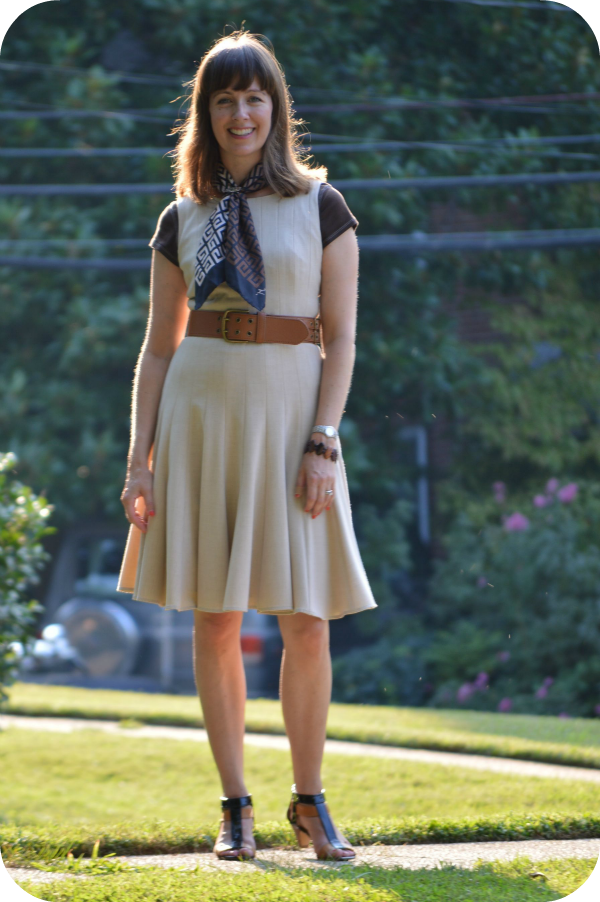 Working mom office outfit idea: Tan fit 'n' flare dress, black/brown accessories
